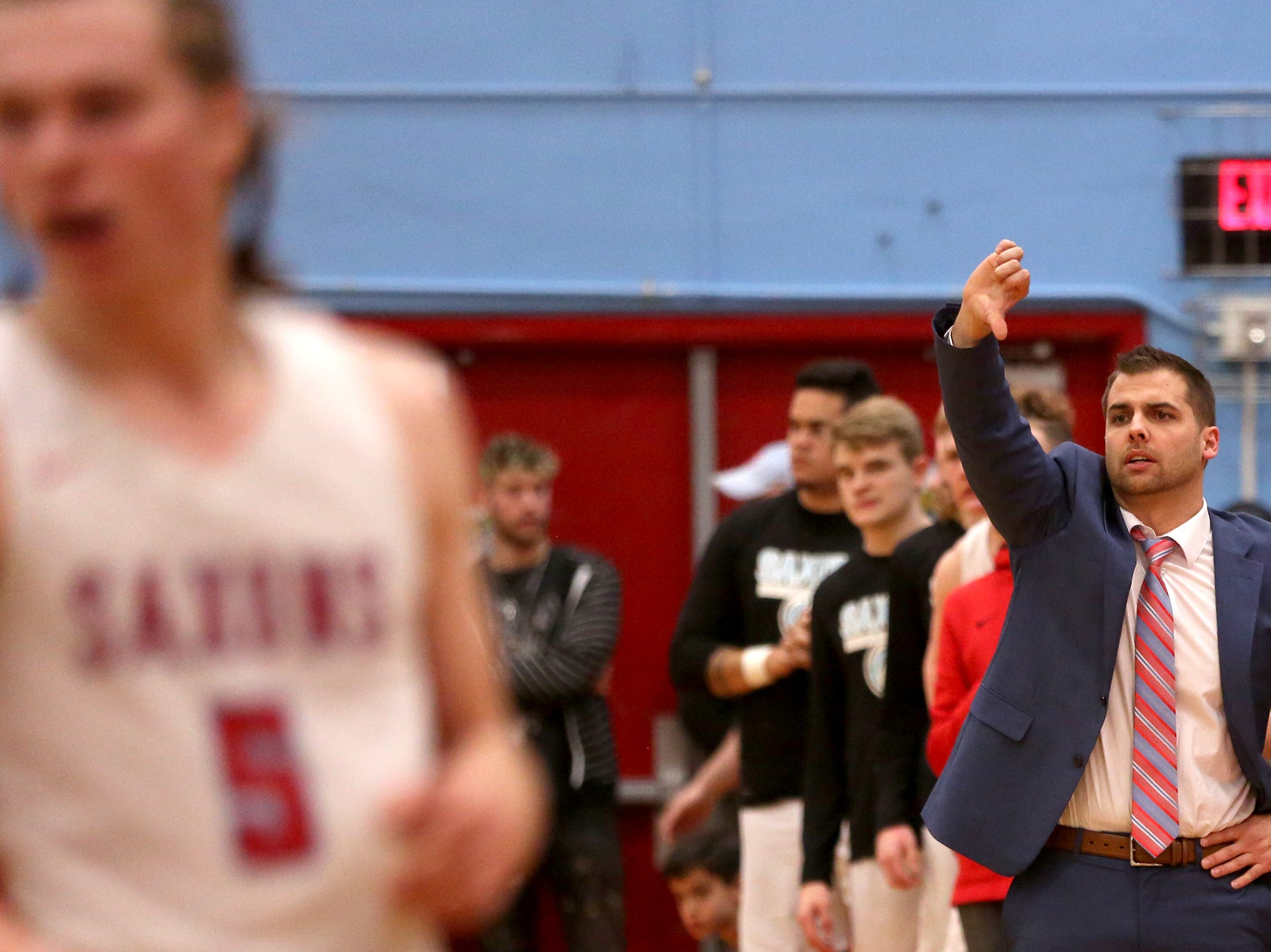 South Salem's head coach Tyler Allen calls to his players during the South Salem vs. West Linn boys basketball OSAA playoff game at South Salem High School on Friday, March 1, 2019.