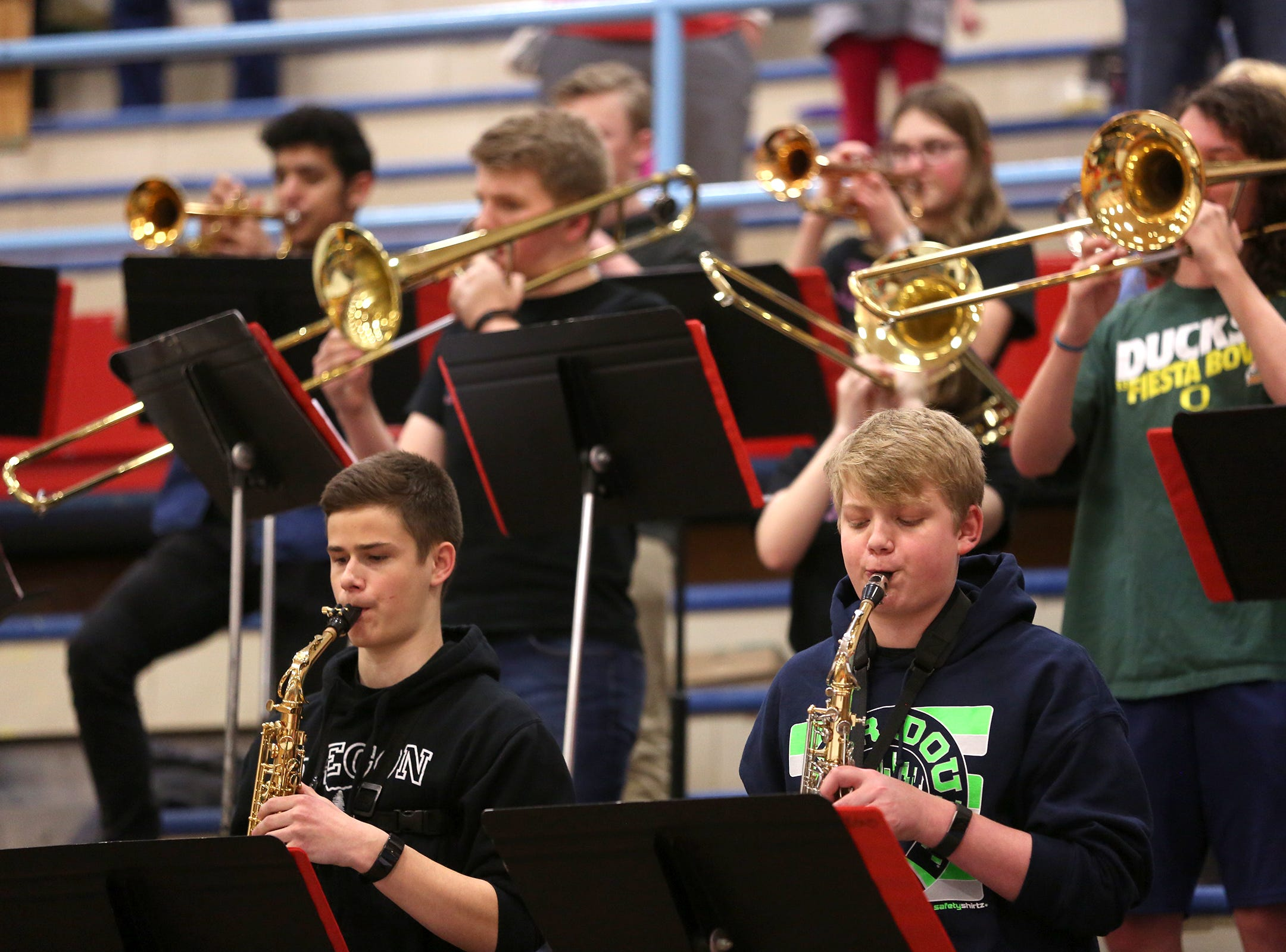 South Salem band students perform during the South Salem vs. West Linn boys basketball OSAA playoff game at South Salem High School on Friday, March 1, 2019.