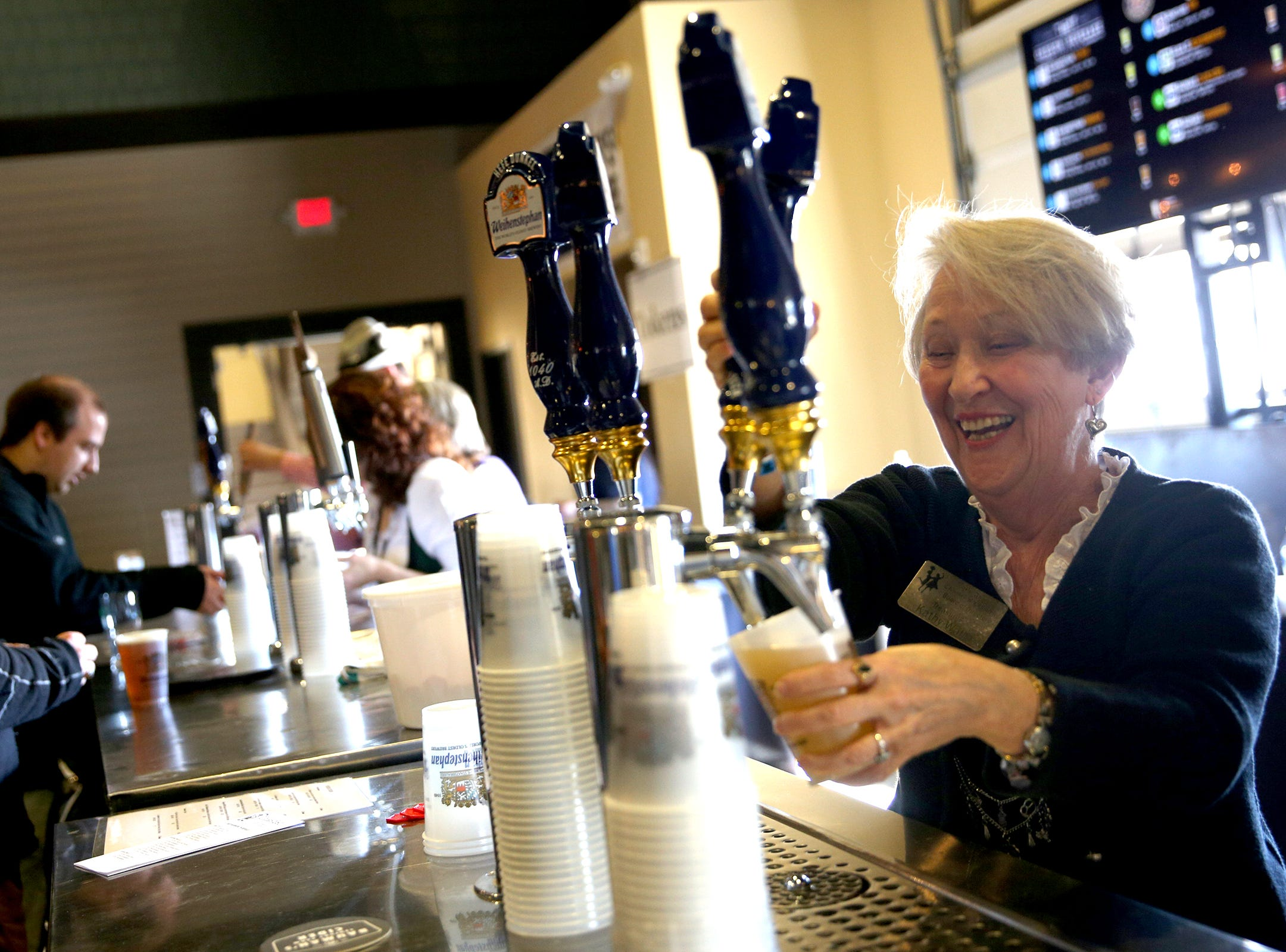 Kathy Wall, treasurer of the Mt, Angel Chamber, bartends at the annual Volksfest in Mt. Angel on Saturday, March 2, 2019.
