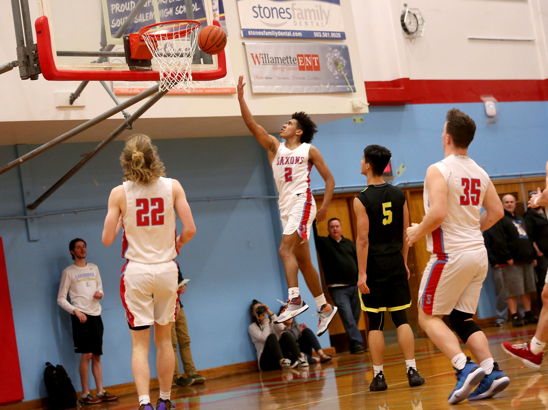 South Salem's Jaden Nielsen-Skinner 2 goes up for a shot during the South Salem vs. West Linn boys basketball OSAA playoff game at South Salem High School on Friday, March 1, 2019.
