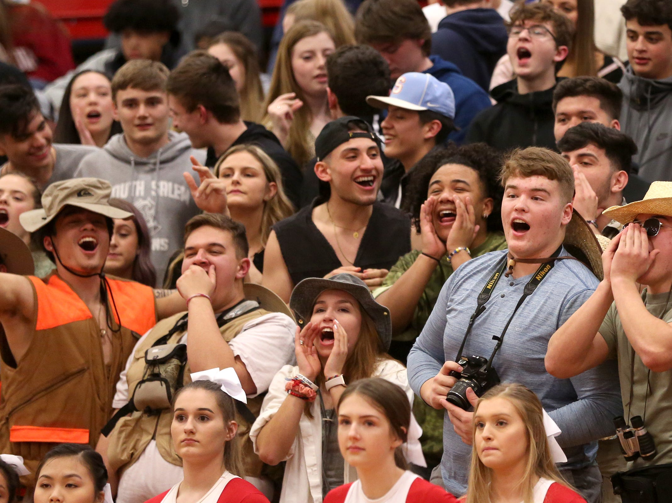 South Salem students cheer on their team during the South Salem vs. West Linn boys basketball OSAA playoff game at South Salem High School on Friday, March 1, 2019.
