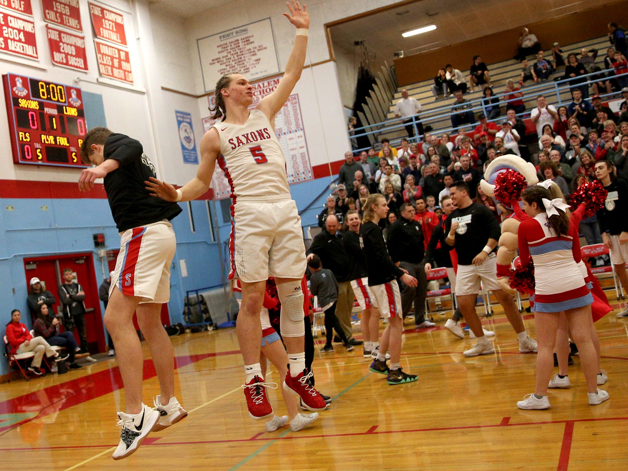 South Salem's Ryan Brown (5) is introduced during the South Salem vs. West Linn boys basketball OSAA playoff game at South Salem High School on Friday, March 1, 2019.