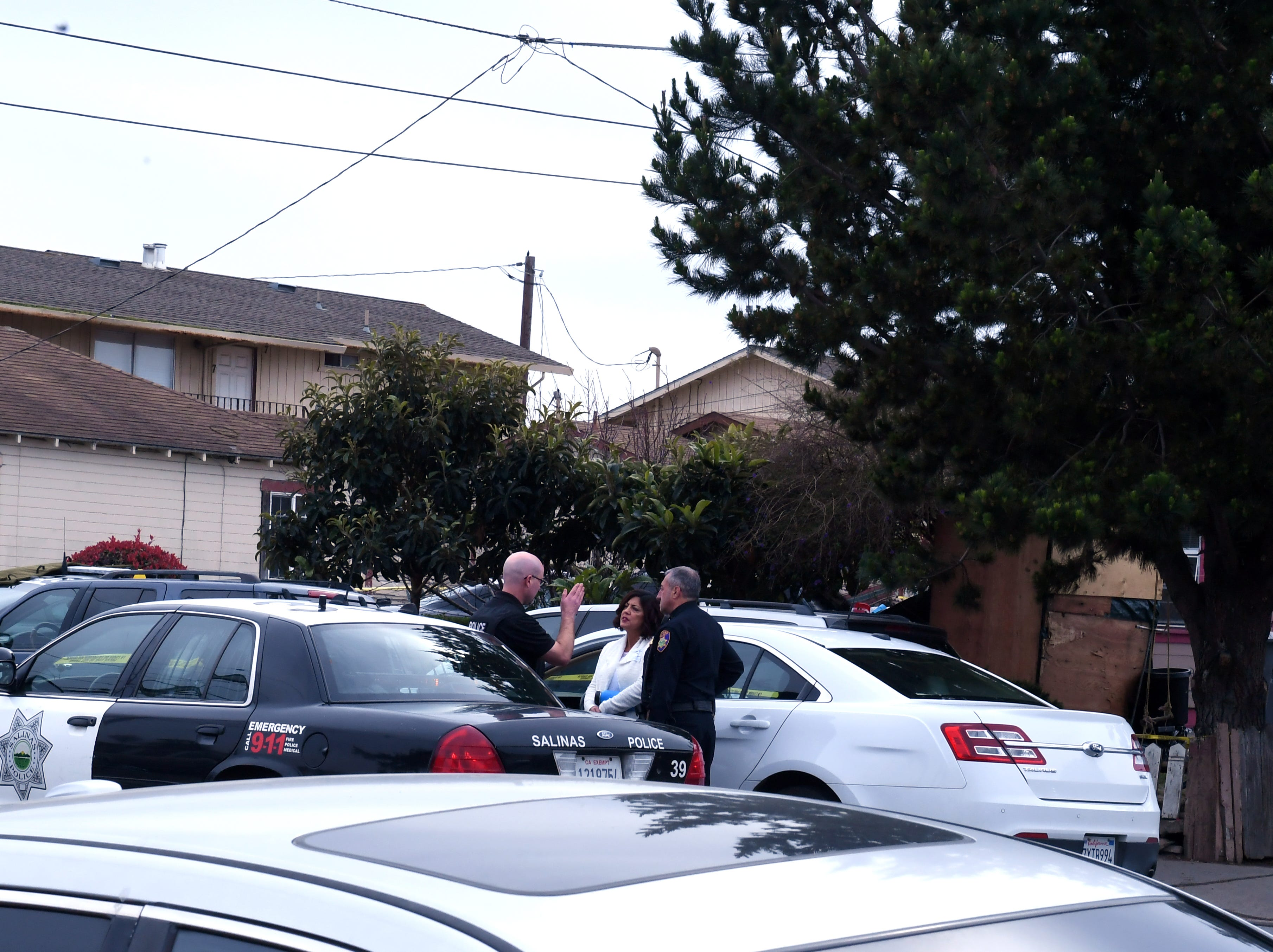 Salinas police and members of the Monterey County District Attorney's Office respond to the scene of an officer-involved shooting Friday.
