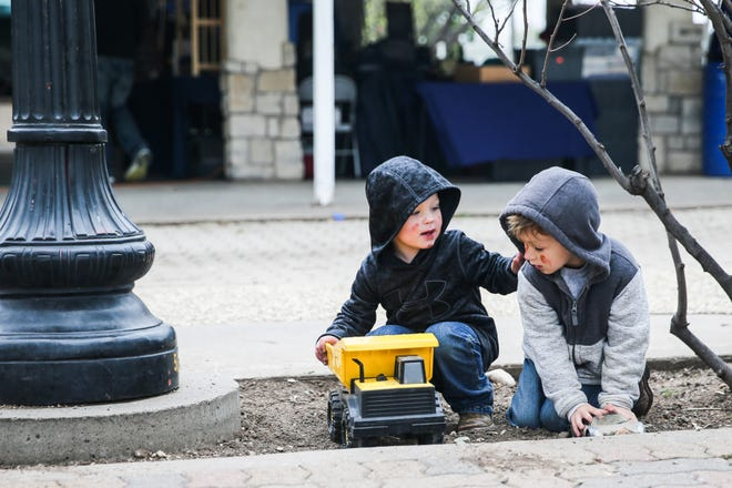 Kooper Enna, 4, and Brantley Raines, 5, play with trucks during the Texas Independence Day celebration Saturday, March 2, 2019, at El Paseo de Santa Angela.
