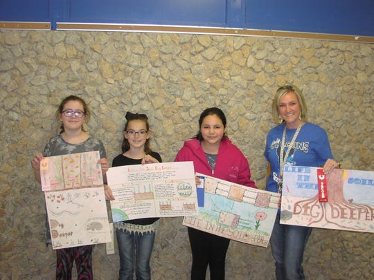 Fourth grade Conservation Poster Contest Winners for Veribest Elementary are, from left, Lyla  Gassiot, fourth place; Emmilee Pfluger, third; and Leighla Ruiz, first place.  Fourth Grade teacher Shanna Treadaway holds Maycie Jackson's second place poster.  Leighla Ruiz was selected as the county wide fourth grade winner and will receive a plaque at the Conservation Banquet on March 28.
