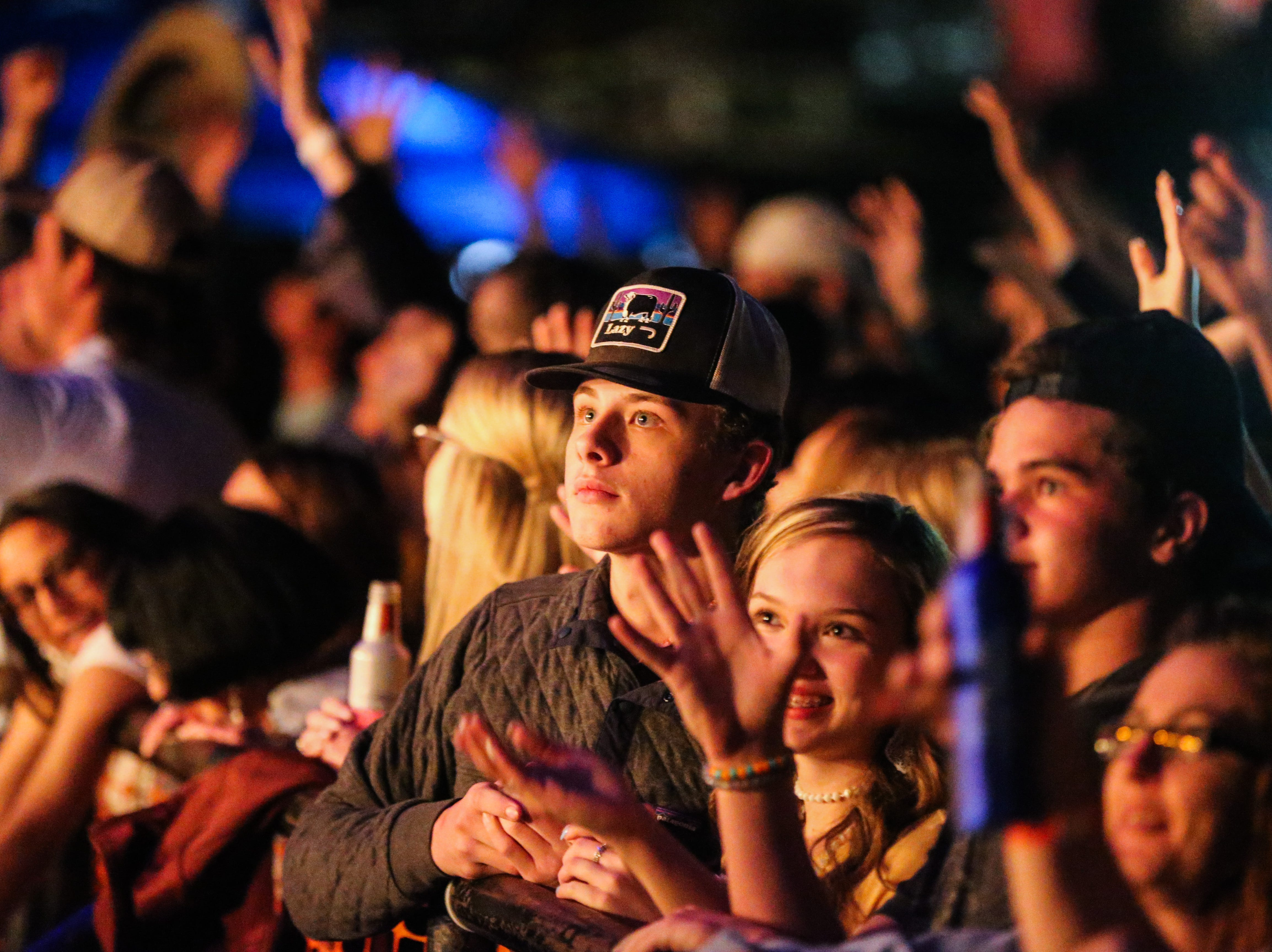 Concert goers cheer on as announcers take the stage before Flatland Cavalry performs during Wild West Fest Friday, March 1, 2019, at the Bill Aylor Sr. Memorial RiverStage.