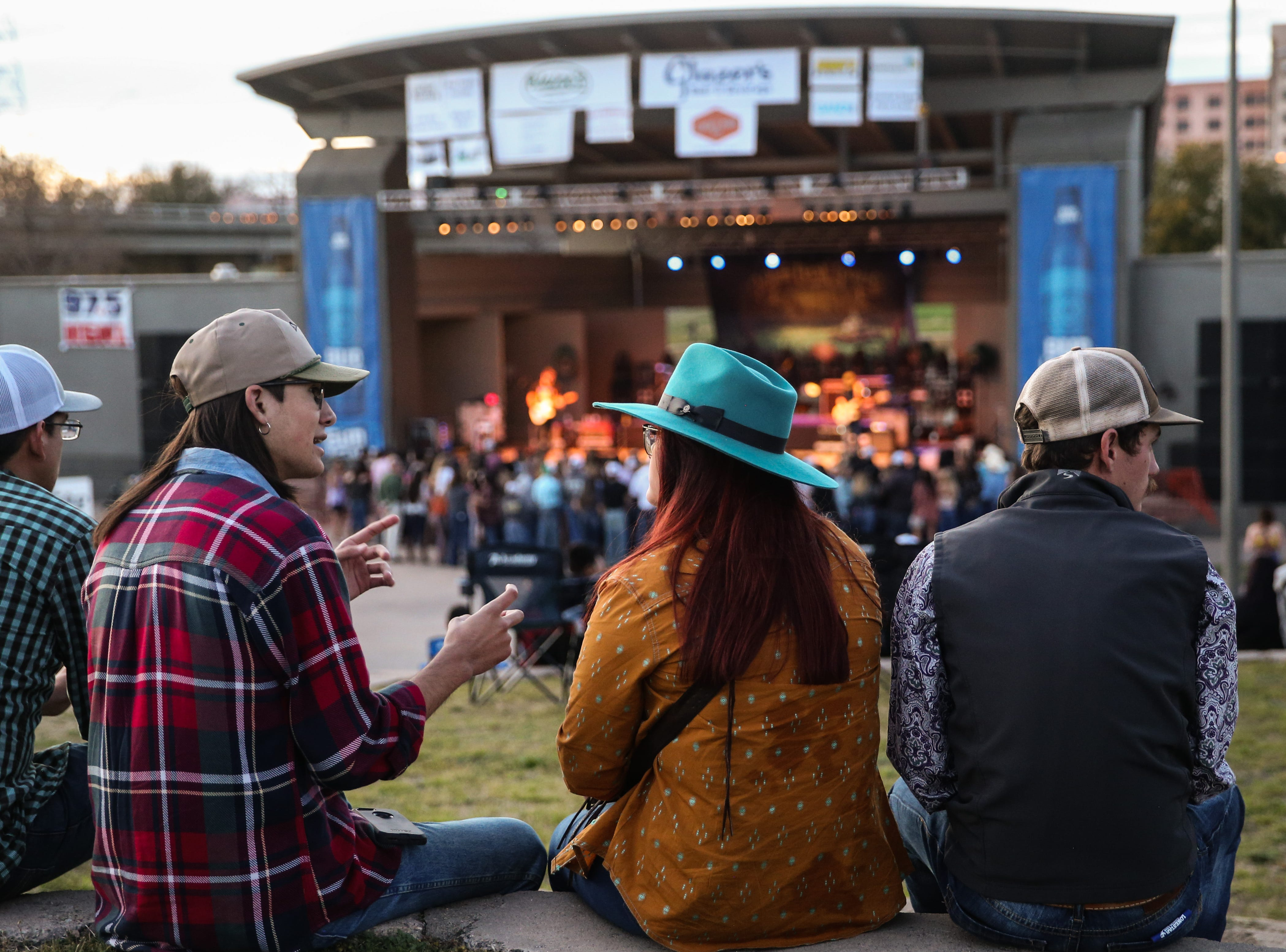 Concert goers hang out as Kody West band performs during Wild West Fest Friday, March 1, 2019, at the Bill Aylor Sr. Memorial RiverStage.