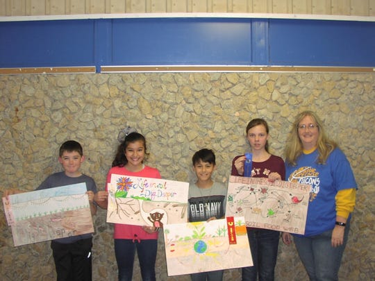 Veribest Elementary School fifth-grade conservation poster contest winners are, from left, Coltyn Webb, fourth place, Shaelee Leal, third; Ruben Rivas, second; and Victoria Gully, first.  Mrs. Janet Phinney (right) is the fifth grade teacher at Veribest.
