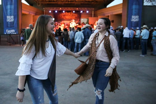 Gabrielle Stobaugh and Grace Keel dance as Kody West performs during Wild West Fest Friday, March 1, 2019, at the Bill Aylor Sr. Memorial RiverStage.