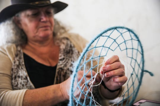 Jolie Confer makes a dream catcher during the Texas Independence Day celebration Saturday, March 2, 2019, at El Paseo de Santa Angela.