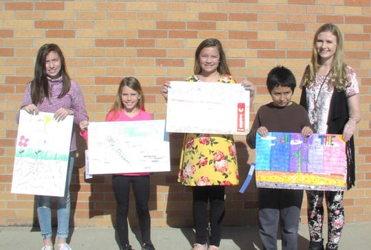 Water Valley Elementary School Fifth Grade Conservation Poster contest winners are, from left,  Brandi DeLuna, fourth place; Sydney Treadaway, second; Heidi Riddle-Rios, third; and Paul DeLuna, first.   At right is fifth grade teacher Megan Doss.  Paul DeLuna was also selected as first place winner for the county wide poster contest and will be recognized at the San Angelo Conservation Awards banquet on March 28.