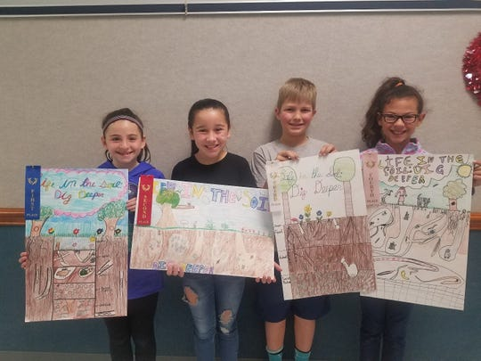 Water Valley Elementary School 4th Grade Conservation Poster contest winners are, from left, Lynlee Peavy, first place; Kalyssa Quintana, second; Cutter Lange, third and Miricle McKinney, fourth.  All four are students in of Melissa Glass.