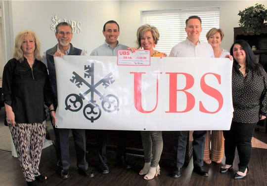 Employees of the San Angelo branch of UBS Financial Services, Inc. donated $1,130 to the San Angelo D.E.S.K. (Donate Educational Supplies for Kids) program.   D.E.S.K. helps provide students in kindergarten through 12th grade in the San Angelo ISD with school supplies they cannot afford with their own means.   From left: Bridget Doyle, Lee Horton, Ryan Barnes, Ruth Wilde, DeeJay Wilde, Julie Kasberg and Susan Scoggin.