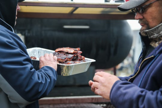 People taste ribs during the Texas Independence Day celebration Saturday, March 2, 2019, at El Paseo de Santa Angela.