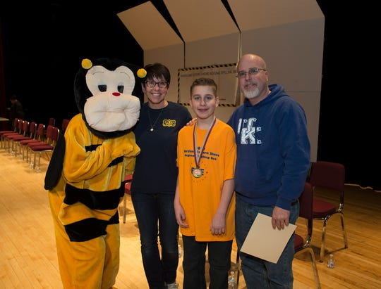 Sixth-grader Austin Loar was joined on stage by his parents, Sheila and Jason, after winning the 2019 Maryland Eastern Shore Regional Spelling Bee at the University of Maryland Eastern Shore on Saturday, March 2, 2019.
