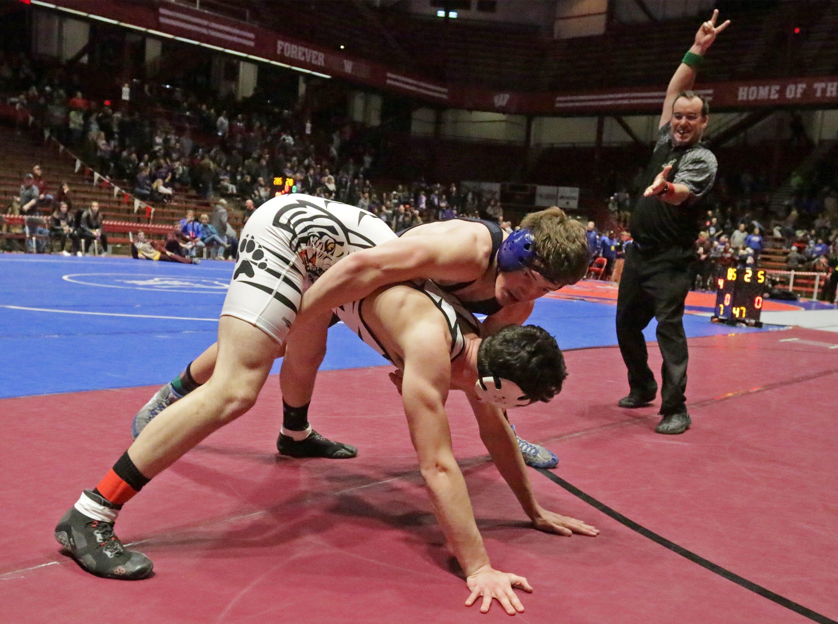 Stratford's Jediah Knetter, bottom, wrestles Random Lake's Brock Upson in a 195-pound match, Saturday, March 2, 2019, in Madison, Wis.