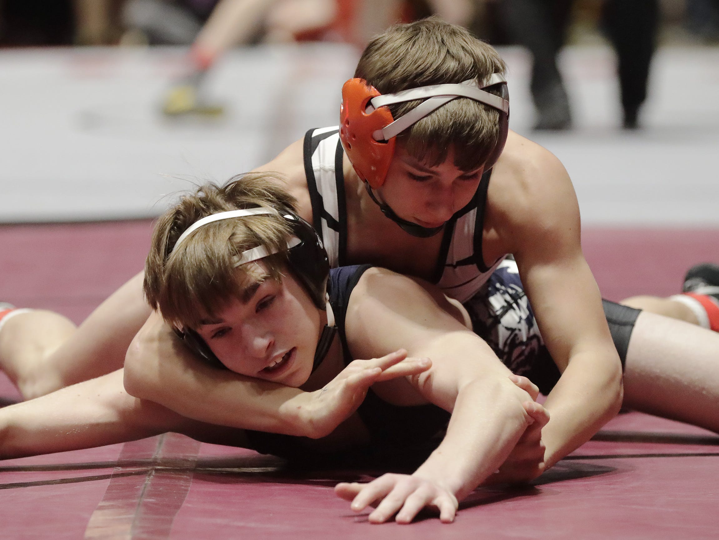 Random Lake's Ethan Sanfelippo, left, is under the grip of Stratford's Gavin Drexler, during a 113-pound bout at the WIAA state team wrestling action, Saturday, March 2, 2019, in Madison, Wis.