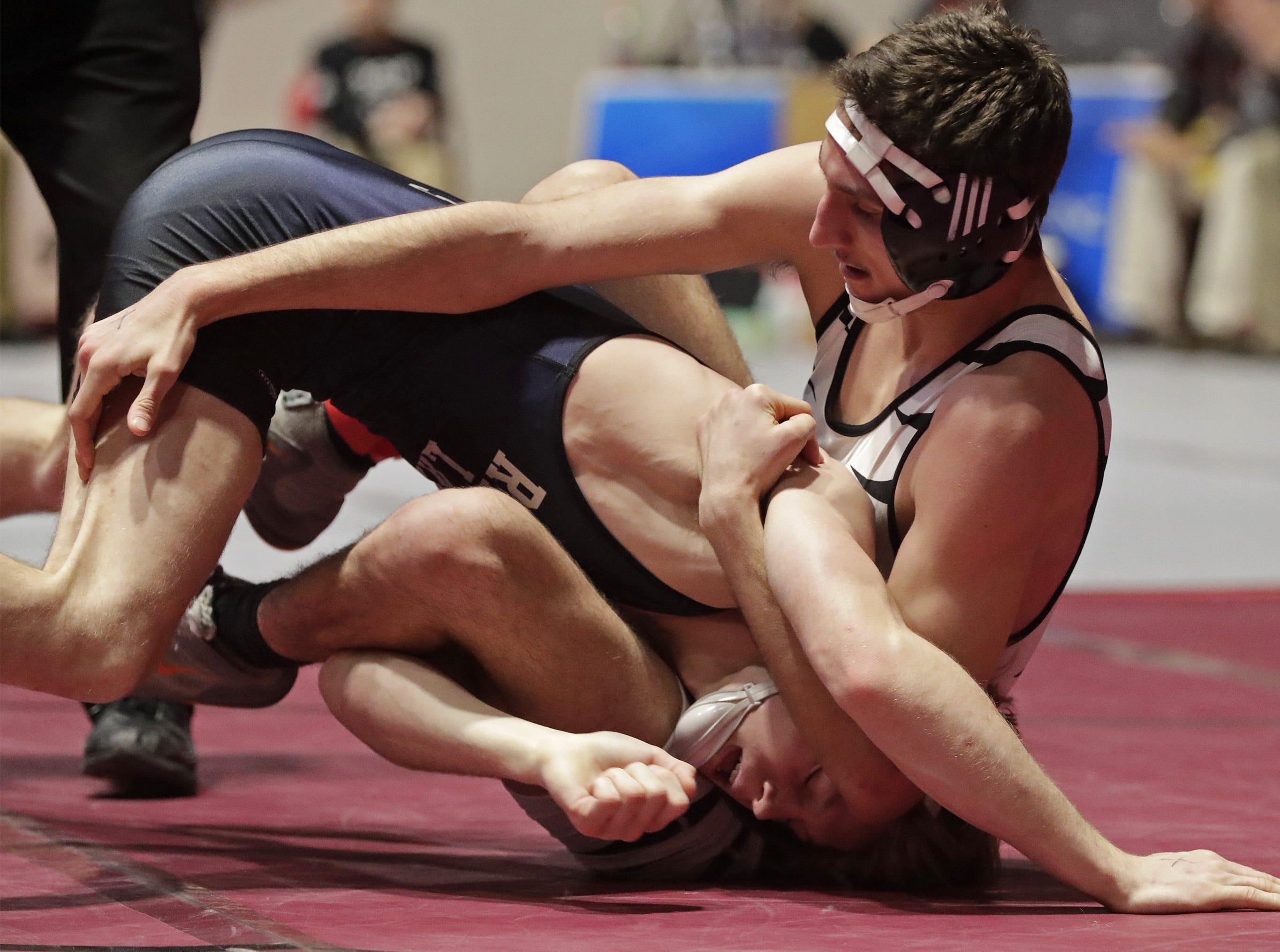 Stratford's Oscar Telschow, right, wrestles Random Lake's Aiden Vandenbush in a 152-pound match, Saturday, March 2, 2019, in Madison, Wis.