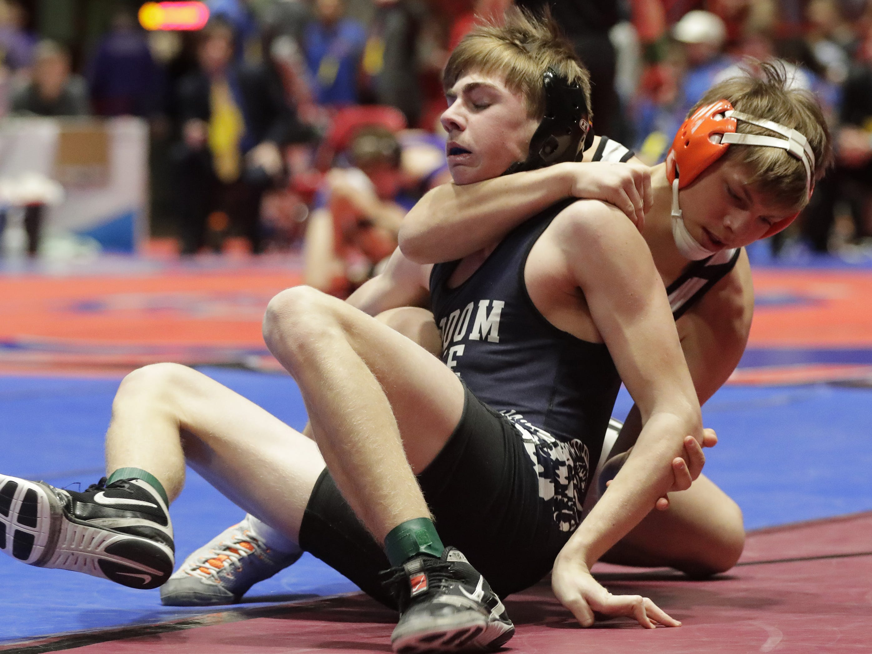 Stratford's Jacob Heiden, right, keeps a grip on Random Lake's Hayden Scholler during a 138-pound match, Saturday, March 2, 2019, in Madison, Wis.