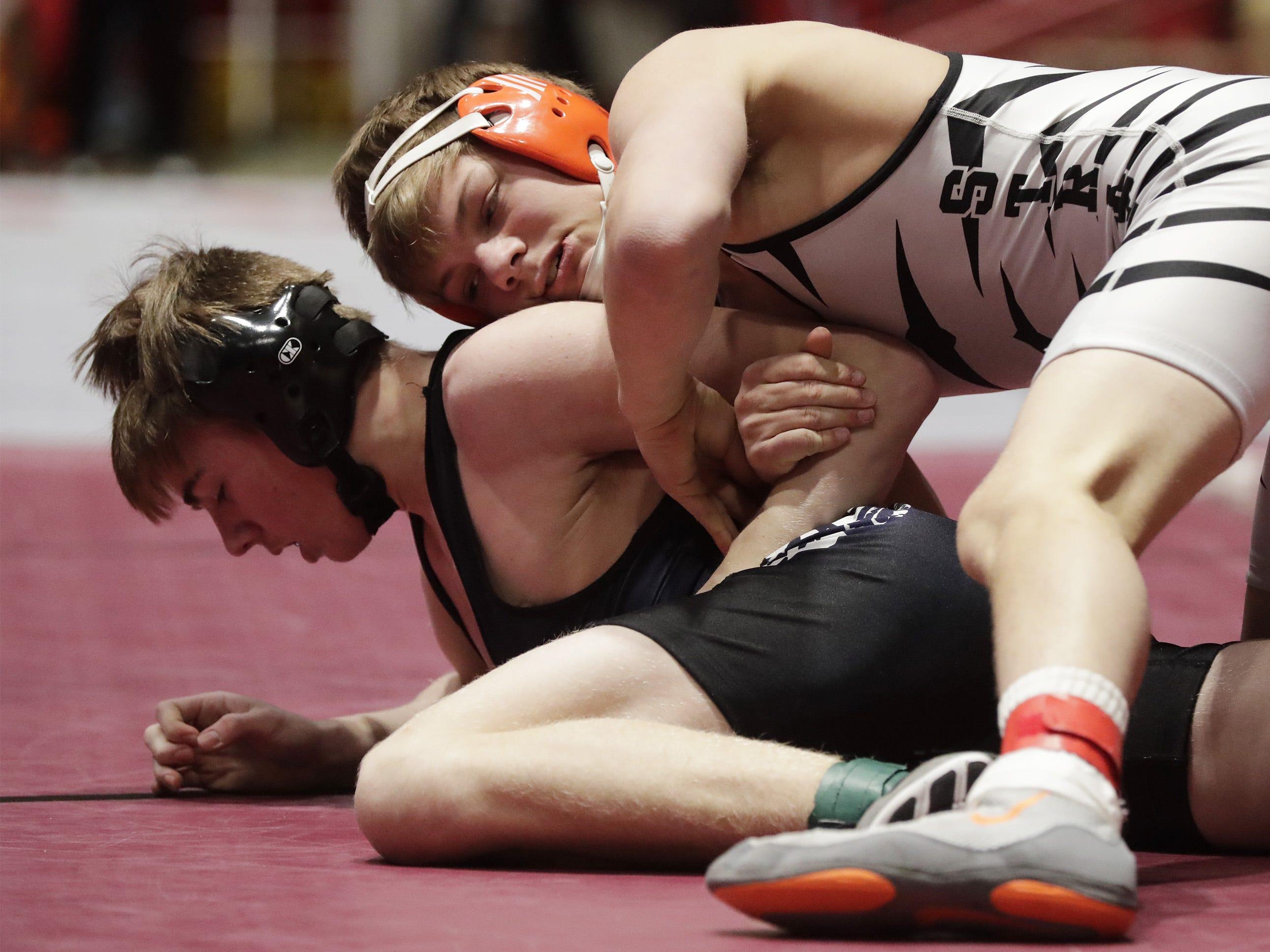 Stratford's Jacob Heiden keeps a grip on Random Lake's Hayden Scholler during a 138-pound match, Saturday, March 2, 2019, in Madison, Wis.