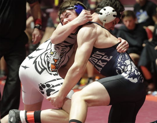 Stratford's Jediah Knetter, left, grips Random Lake's Brock Upson in a 195-pound match Saturday during a WIAA state team wrestling semifinal in Madison.