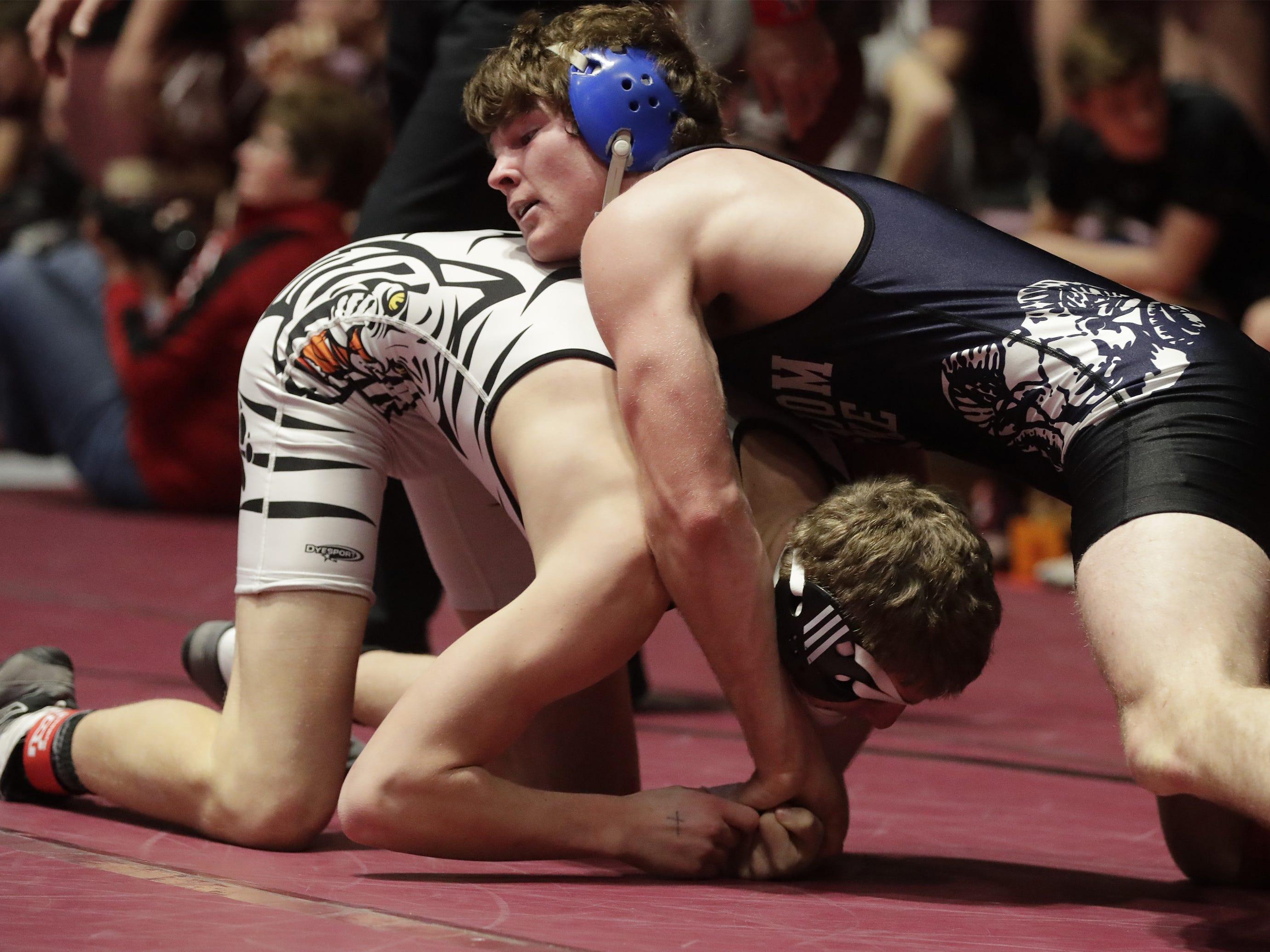 Random Lake's Grayson Vandenbush, top, wrestles Stratford's Logan Rueth during a 160-pound bout, Saturday, March 2, 2019, in Madison, Wis.