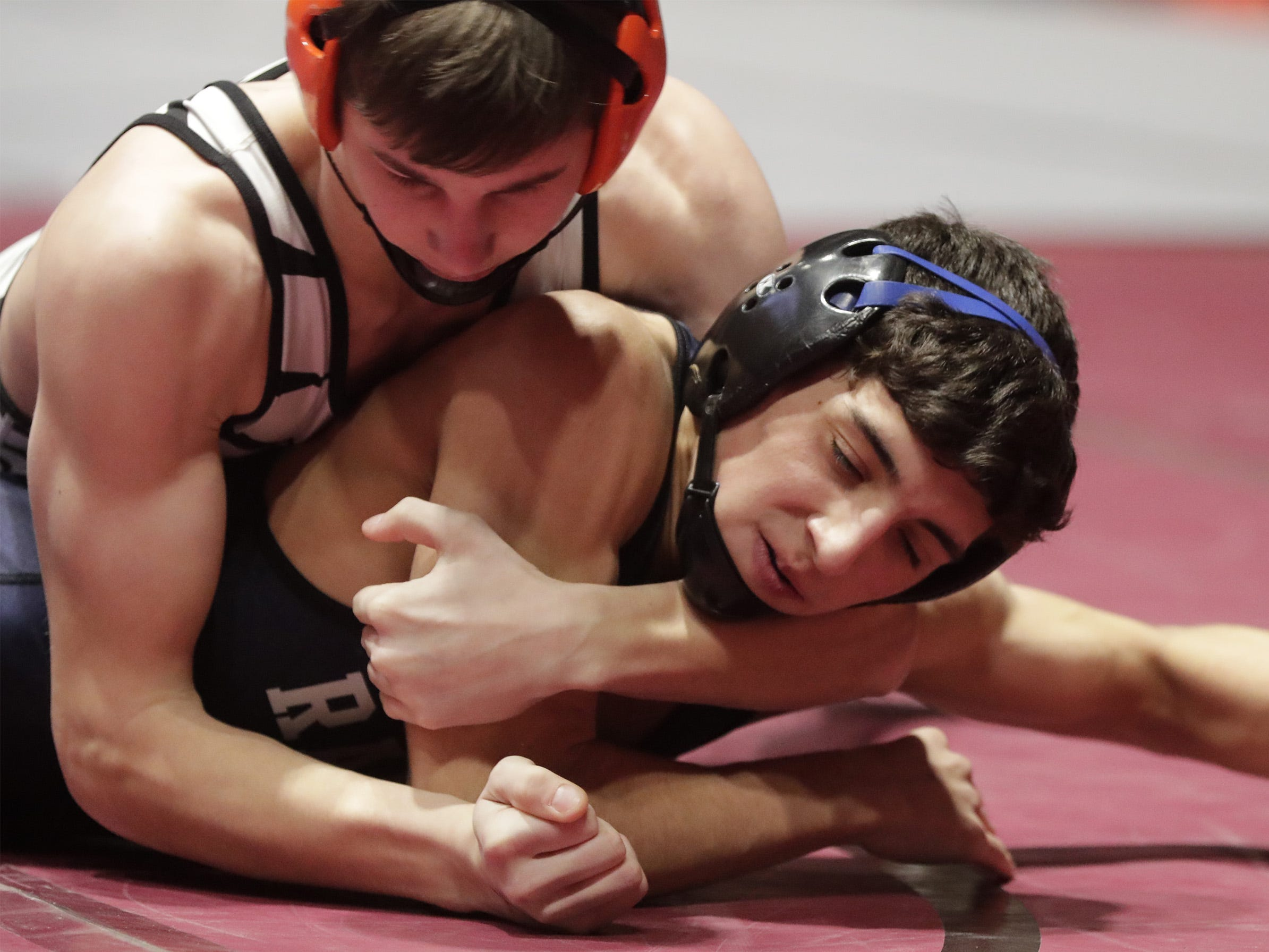 Stratford's Dillon Kirsch, top, grips Random Lake's Parker Scholler in a 126-pound match, Saturday, March 2, 2019, in Madison, Wis.