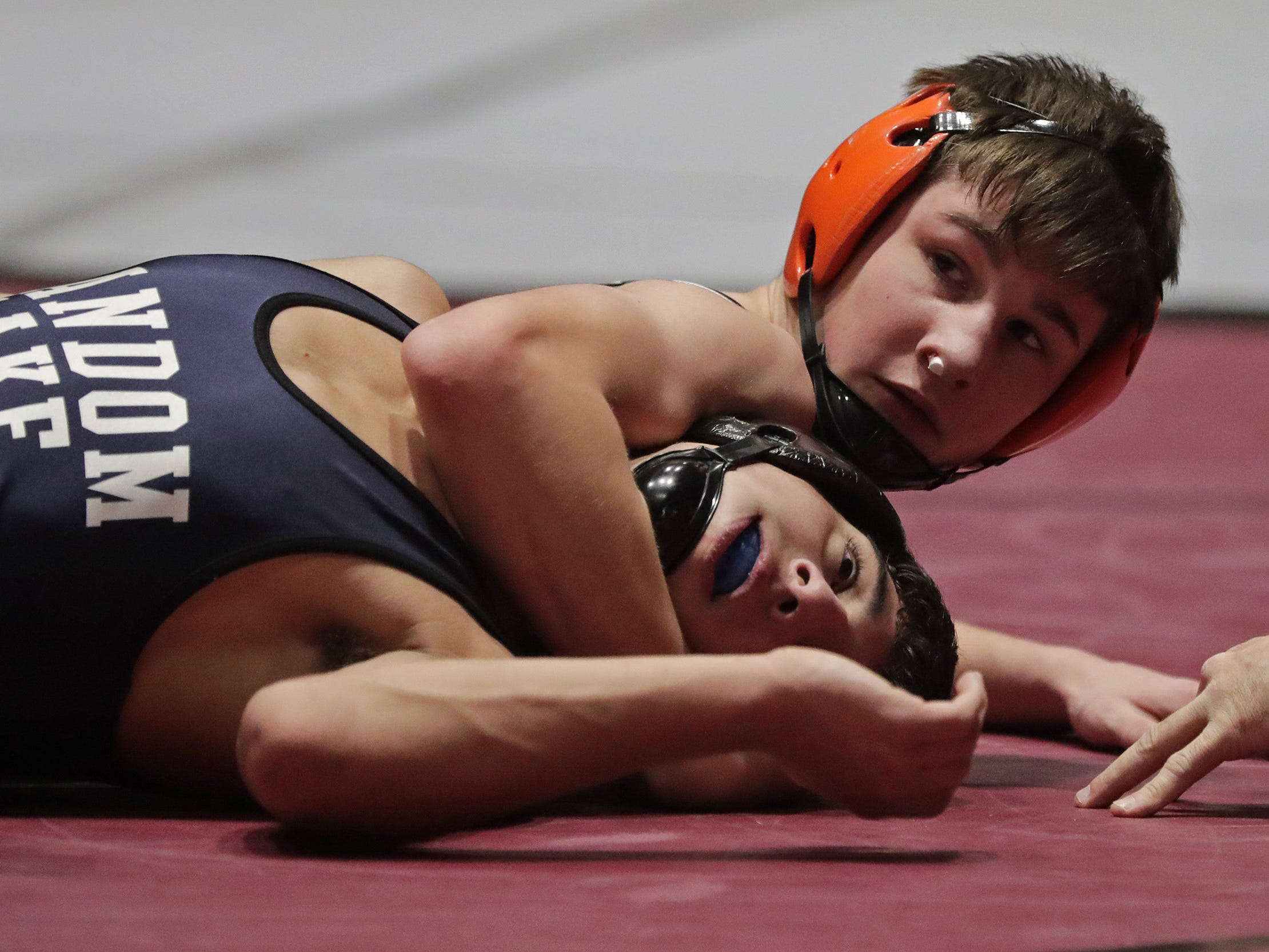 Stratford's Dillon Kirsch, right, wrestles Random Lake's Parker Scholler in a 126-pound match, Saturday, March 2, 2019, in Madison, Wis.