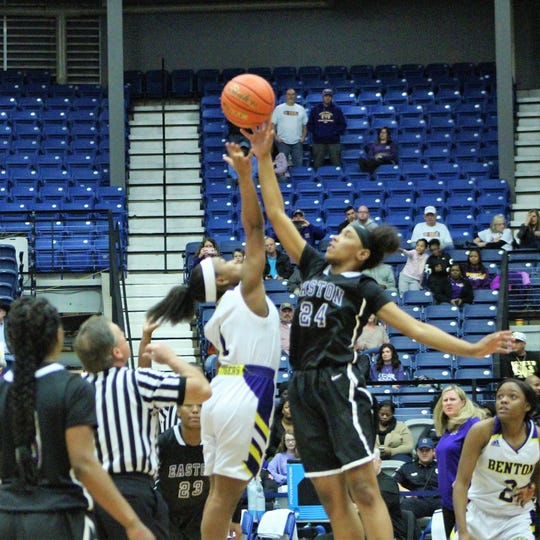 Benton's (1) and Warren Easton's Skylar Davis (24) battle for the ball in the opening tip off of the 2019 LHSAA Class 4A Girls' Basketball State Championship Game at the Rapides Parish Coliseum in Alexandria on Friday night.