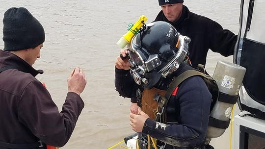 Divers made repeated trips into the Red River to recover the downed aircraft.
