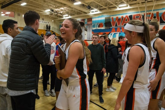 Washington players celebrate after defeating Rapid City Central 47-33, Friday, March 1, 2019 in Sioux Falls, S.D. Washington qualifies for the Class AA state tournament.