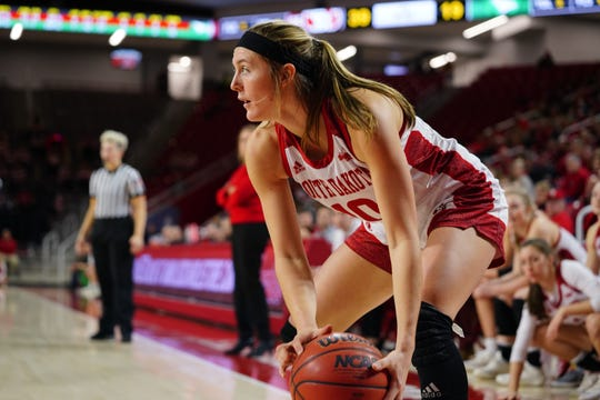 South Dakota senior Allison Arens surveys the floor during Saturday's game against North Dakota on March 2, 2019. Arens finished with 18 points in the final home game of her career.