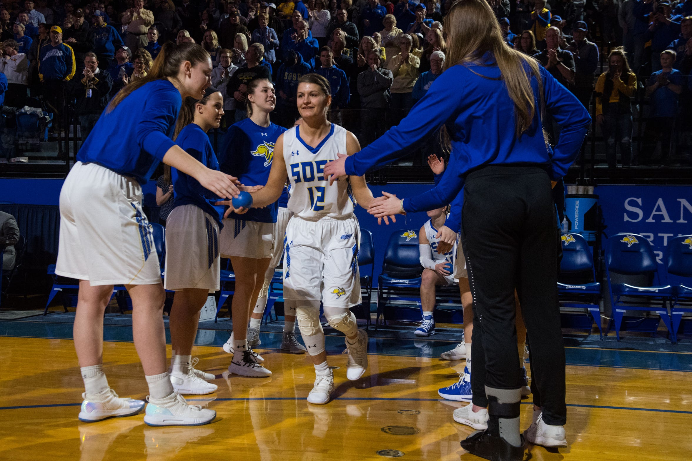 SDSU's Macy Miller (12) gets introduced by the crowd before a game against Western Illinois, Saturday, March 2, 2019 in Brookings, S.D.