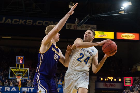 Western Illinois's Brandon Gilbeck (52) blocks SDSU's Mike Daum (24) during a game, Saturday, March 2, 2019 in Brookings, S.D.
