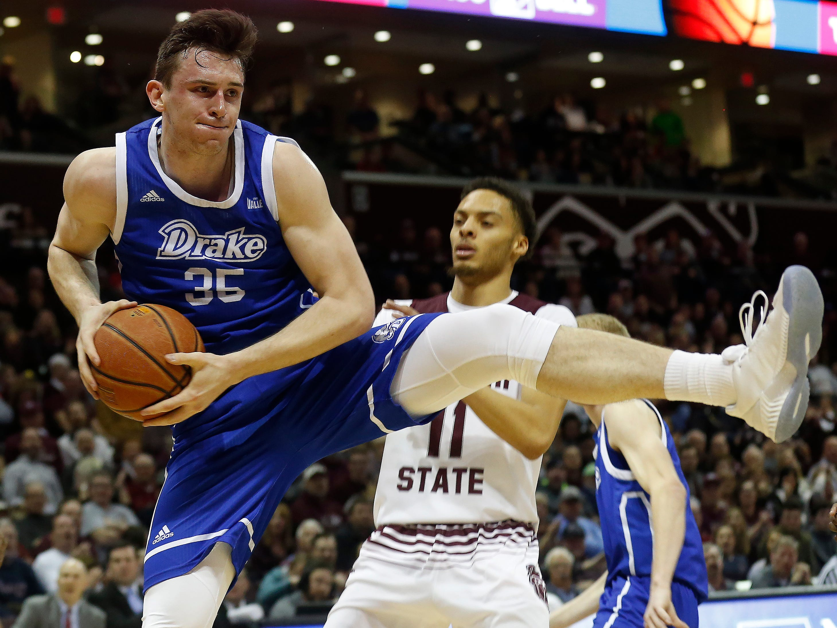Nick McGlynn, of Drake, comes down with a rebound during the Bulldogs 73-62 over Missouri State at JQH Arena on Saturday, Mar. 2, 2019.
