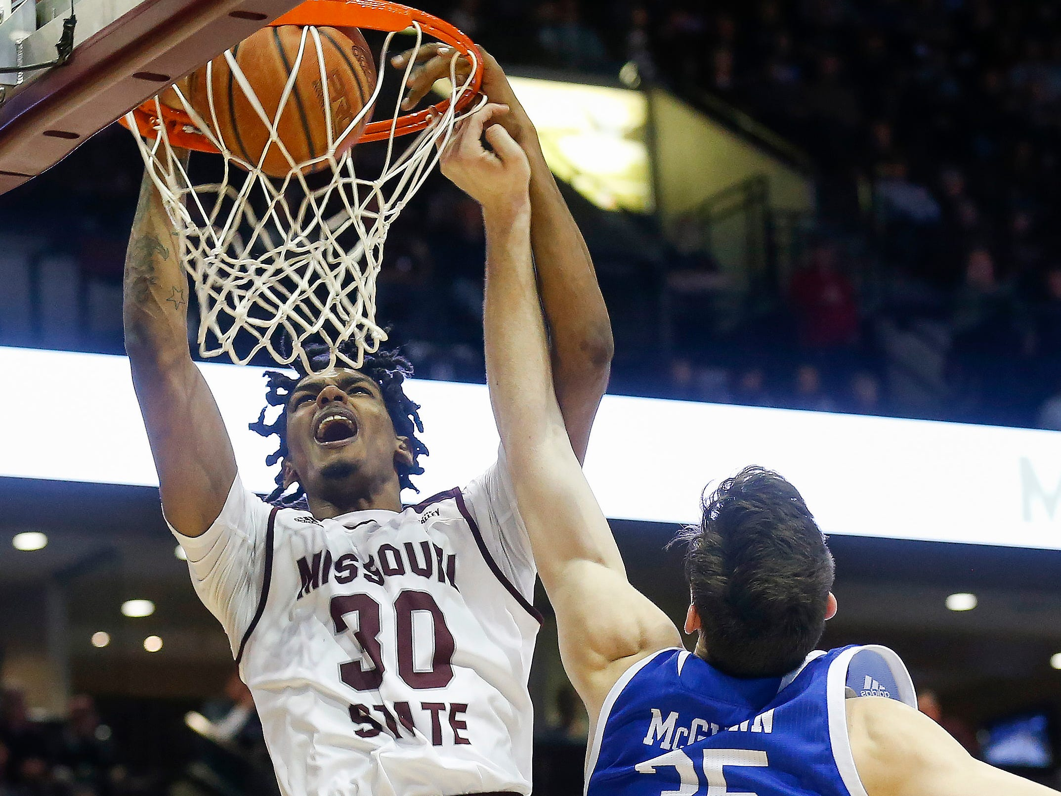 Tulio Da Silva dunks the ball during the Missouri State game against Drake at JQH Arena on Saturday, Mar. 2, 2019.