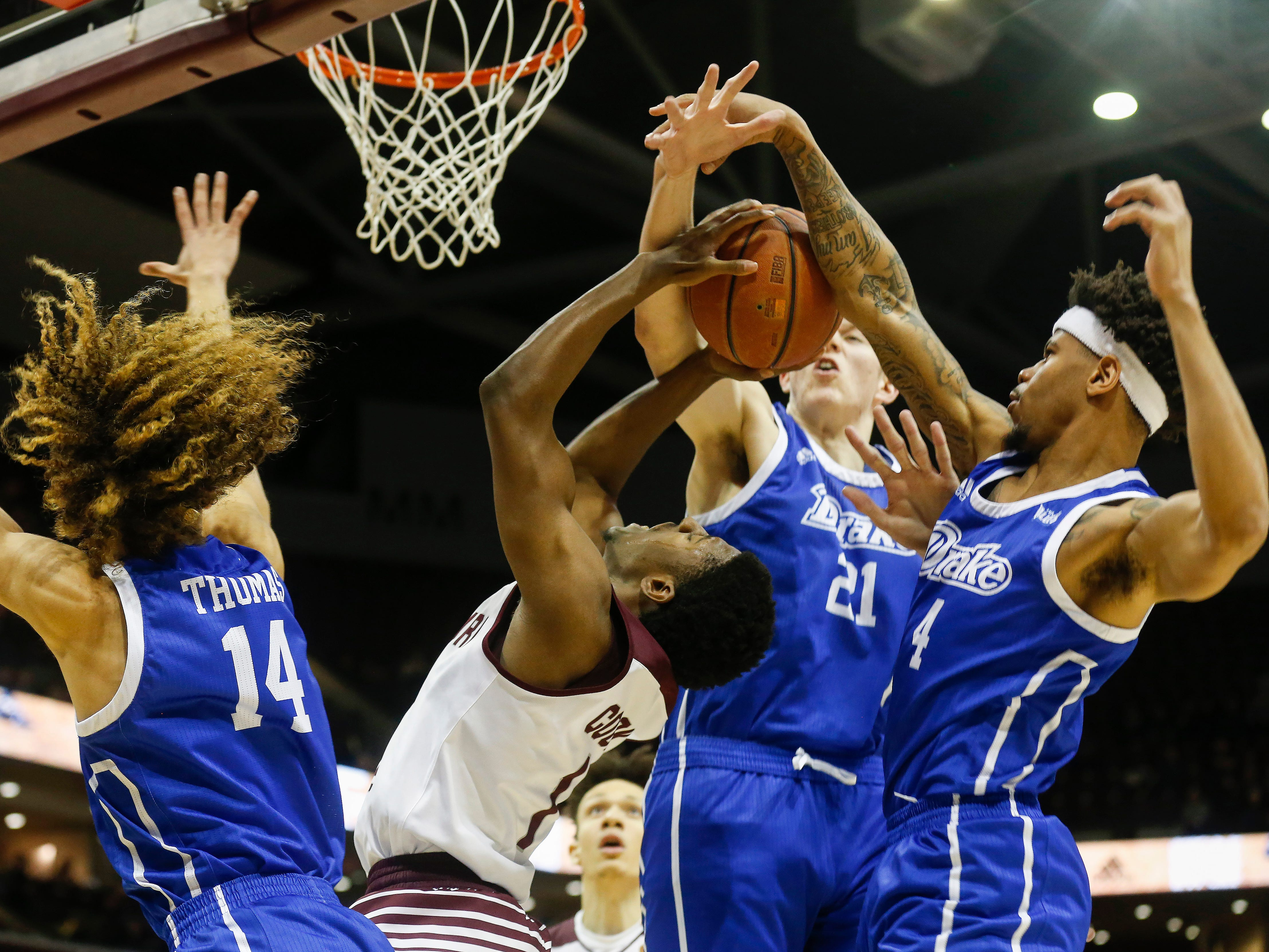 Keandre Cook is swarmed by Drake defenders during Missouri State's game at JQH Arena on Saturday, Mar. 2, 2019.