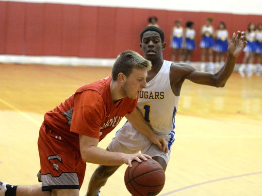 Riverheads' Deacon Moore drives around Surry County's Xavier Brown Friday in the VHSL Class 1 boys state quarterfinals.