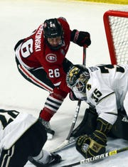 St. Cloud State's Easton Brodzinski tries to jam the puck past Western Michigan goalie Trevor Gorsuch in Friday's NCHC game in Kalamazoo, MI.