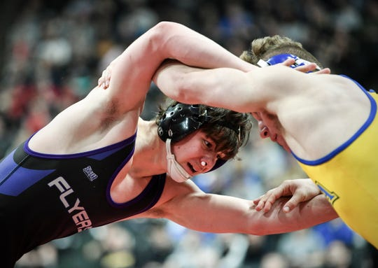 Gabe Nagel of Little Falls wrestles Wyatt Lidberg of St. Michael-Albertville Saturday, March 2, during the state wrestling tournament at the Xcel Energy Center in St. Paul.