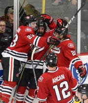 St. Cloud State players celebrate taking a 1-0 lead against Western Michigan in Friday's NCHC contest in Kalamazoo, MI.