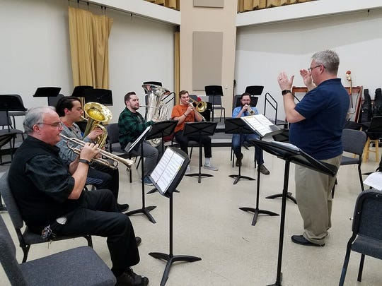 Robert Schmidt directs one of the two Dixie State University Brass Ensemble groups preparing for an upcoming performance slated for March 7 at the Latin America Music Festival.