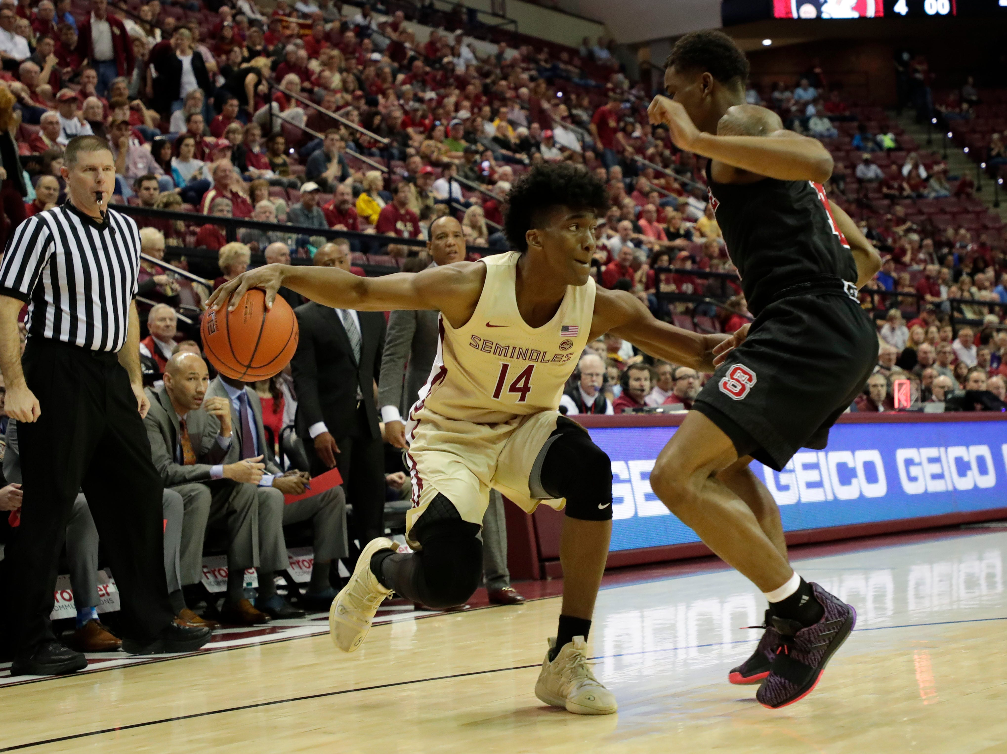 Florida State Seminoles guard Terance Mann (14) dribbles past his defender. The Florida State Seminoles host the NC State Wolfpack at the Tucker Civic Center Saturday, March 2, 2019.
