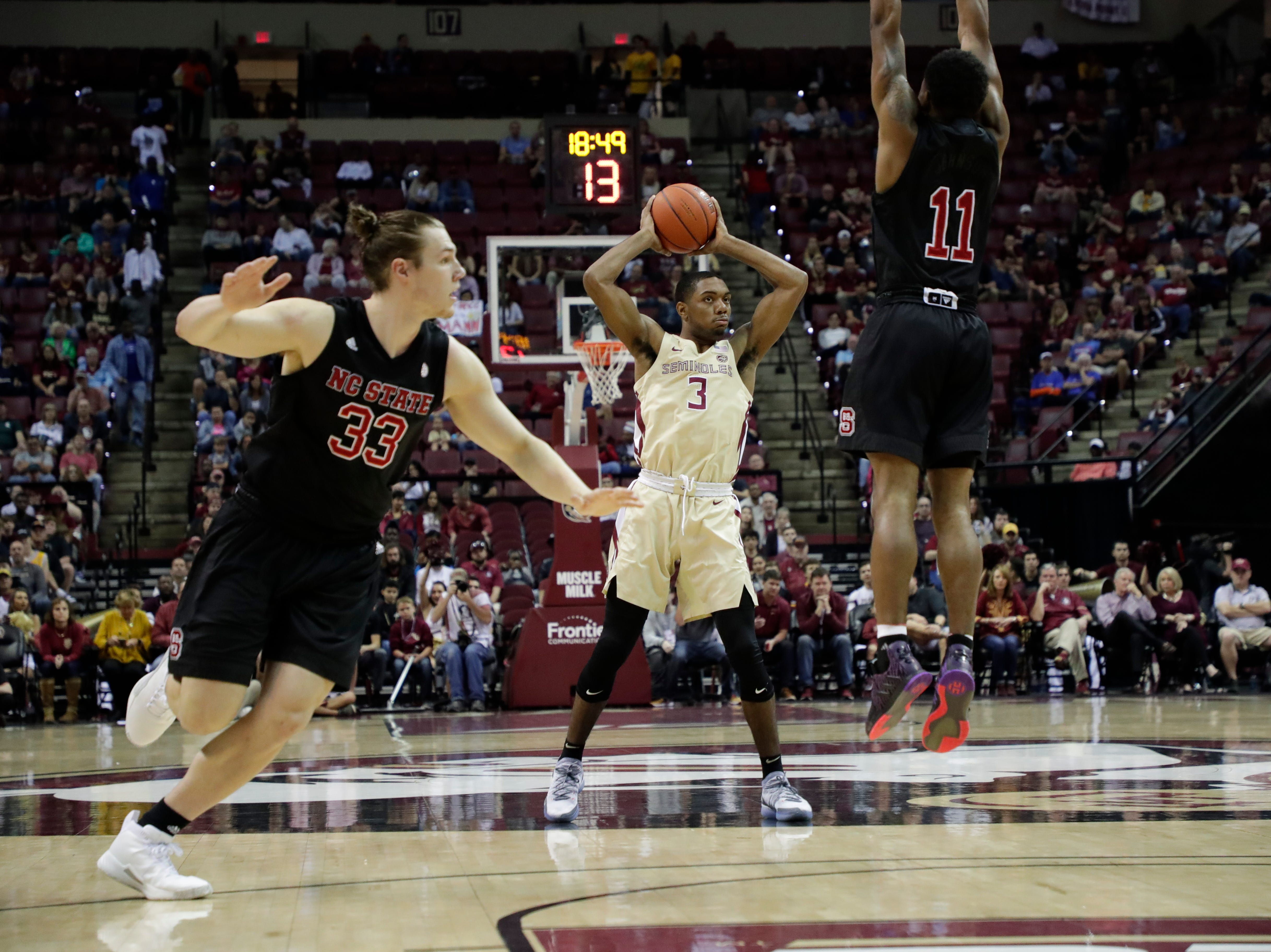 Florida State Seminoles guard Trent Forrest (3) looks to pass to a teammate. The Florida State Seminoles host the NC State Wolfpack at the Tucker Civic Center Saturday, March 2, 2019.