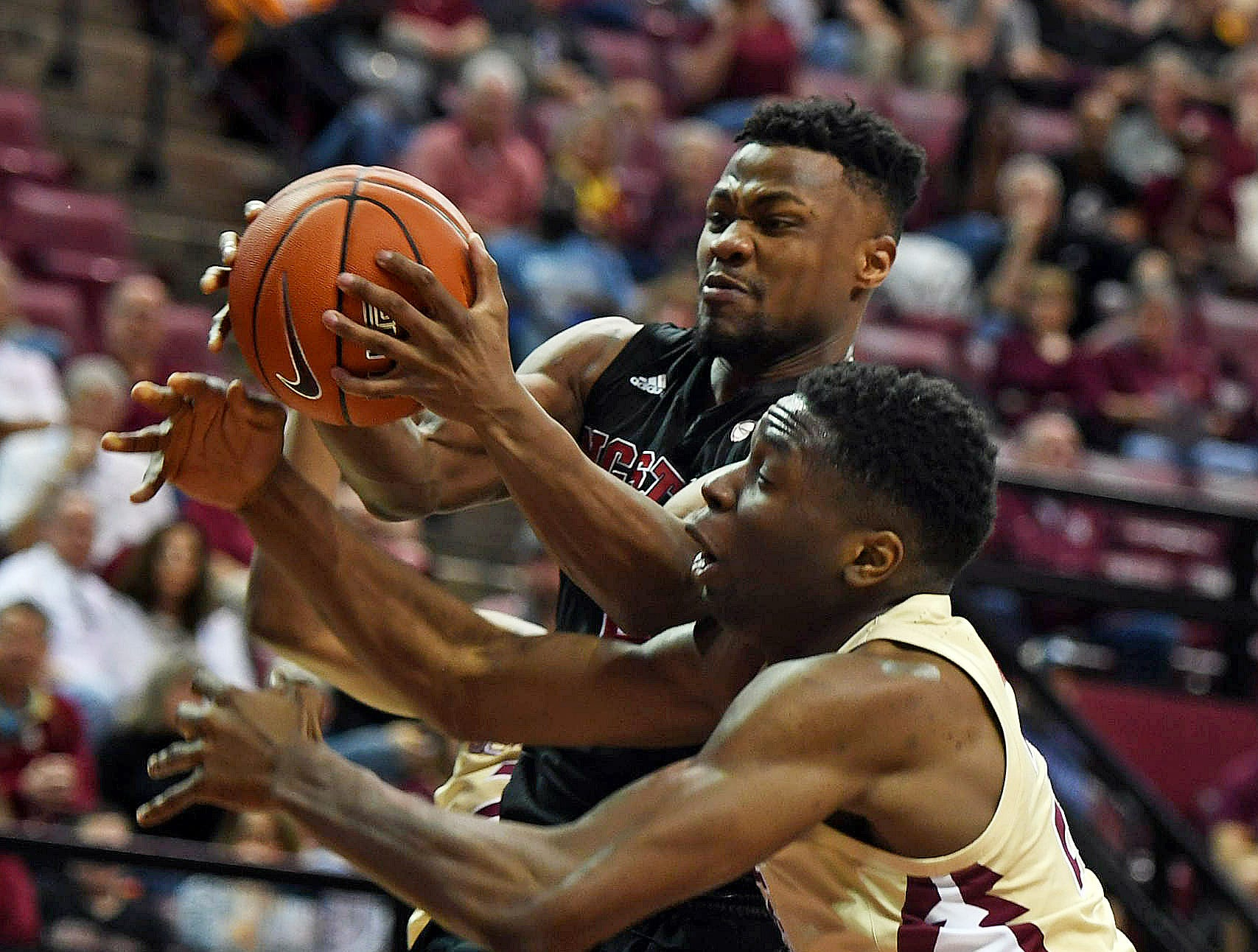 Mar 2, 2019; Tallahassee, FL, USA; North Carolina State Wolfpack guard Torin Dorn (2) fights for a rebound against Florida State Seminoles forward Mfiondu Kabengele (25) during the first half at Donald L. Tucker Center. Mandatory Credit: Melina Myers-USA TODAY Sports