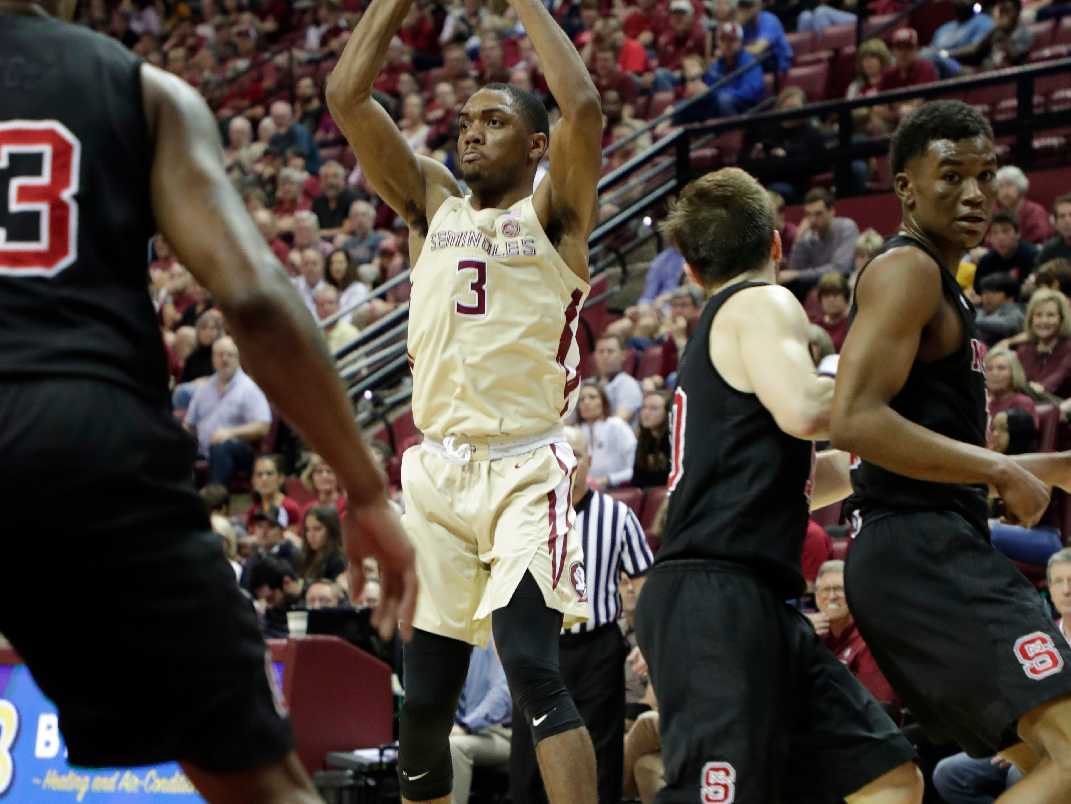 Florida State Seminoles guard Trent Forrest (3) passes to an open teammate. The Florida State Seminoles host the NC State Wolfpack at the Tucker Civic Center Saturday, March 2, 2019.