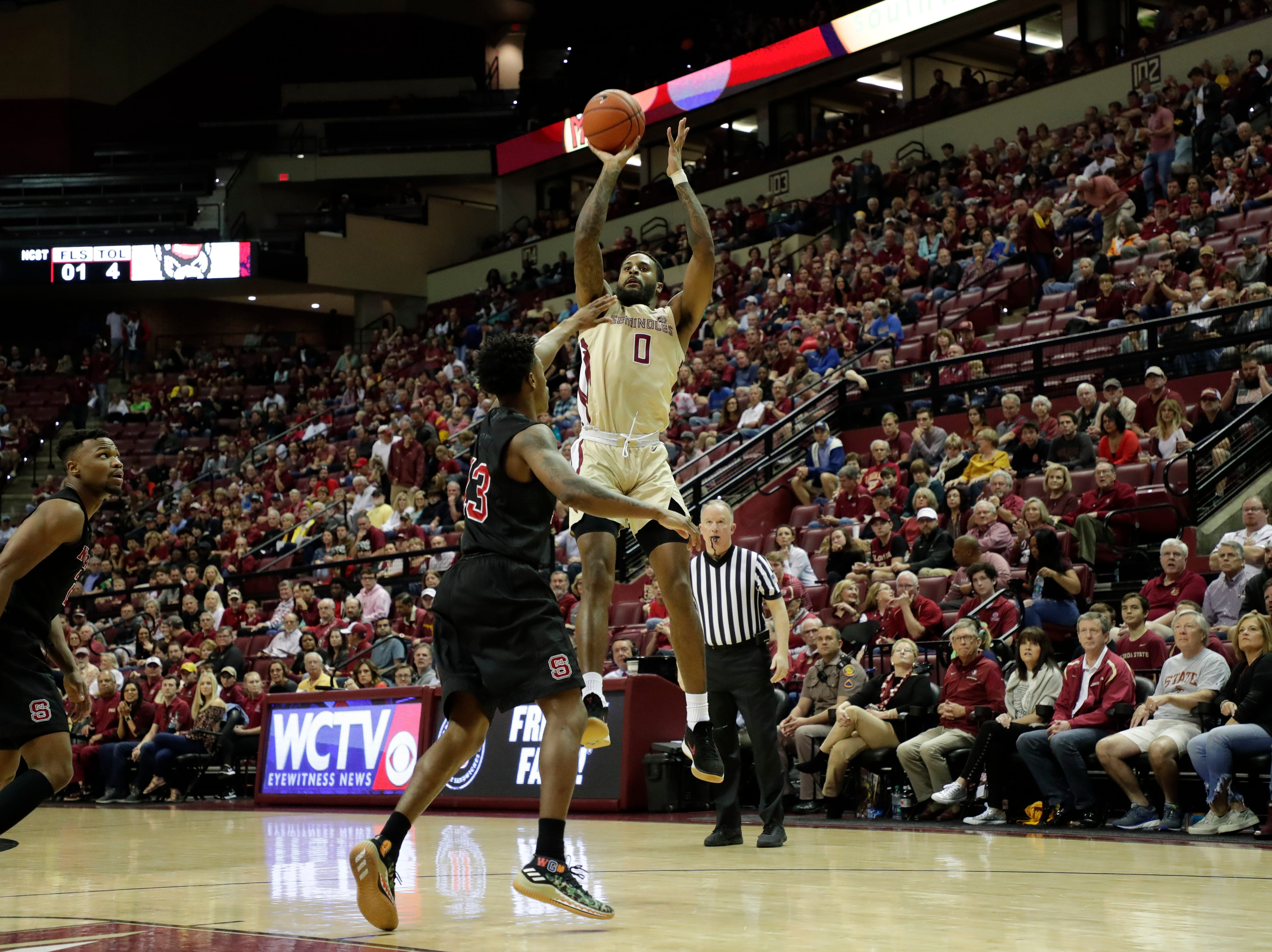 Florida State Seminoles forward Phil Cofer (0) shoots from inside the paint. The Florida State Seminoles host the NC State Wolfpack at the Tucker Civic Center Saturday, March 2, 2019.