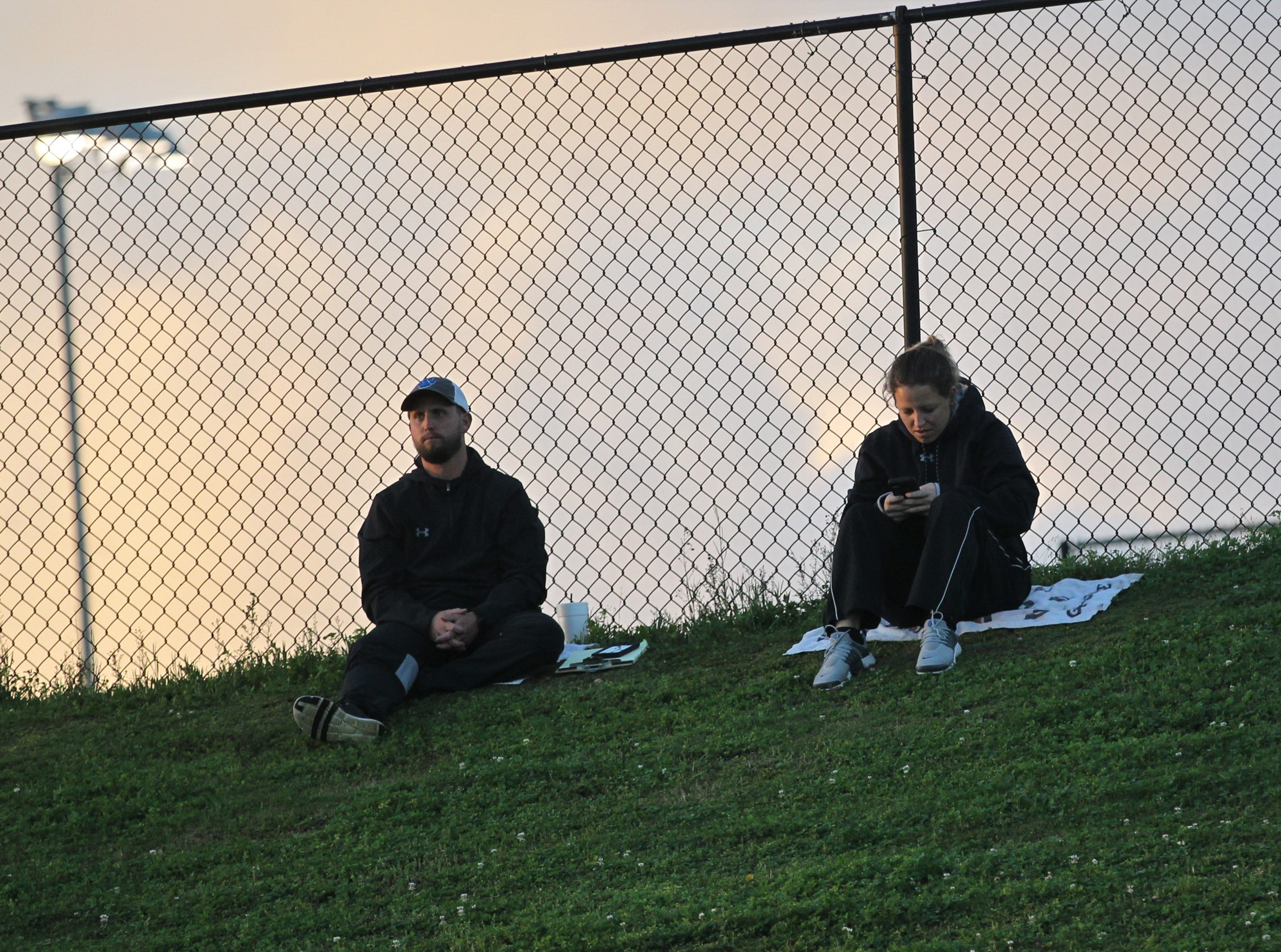 Godby coaches Chelsea Parmer and Ricky Hufty watch play during the 2019 flag football preseason classic at Florida A&M's intramural turf fields on Feb. 27, 2019.