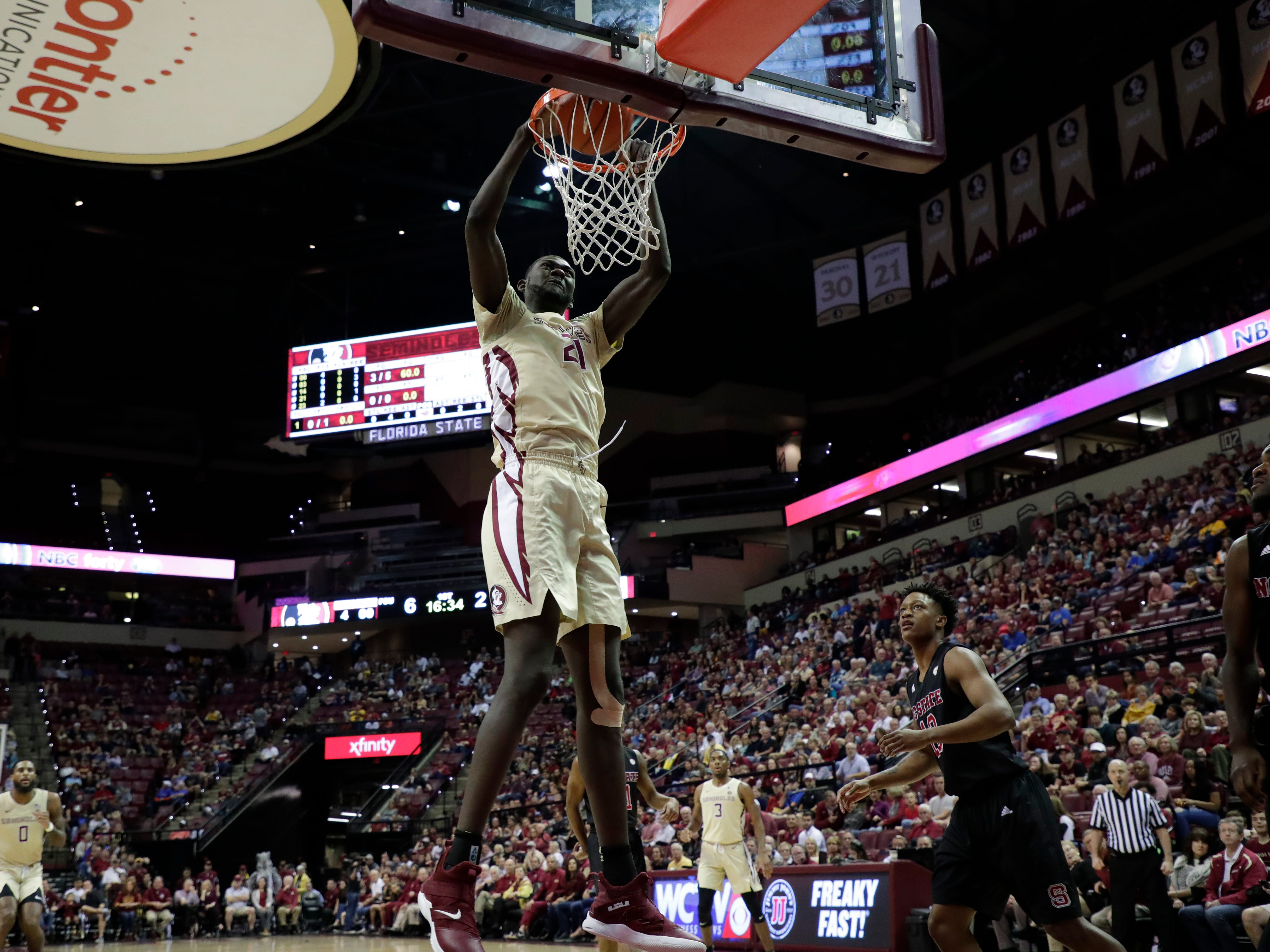 Florida State Seminoles center Christ Koumadje (21) dunks the ball. The Florida State Seminoles host the NC State Wolfpack at the Tucker Civic Center Saturday, March 2, 2019.
