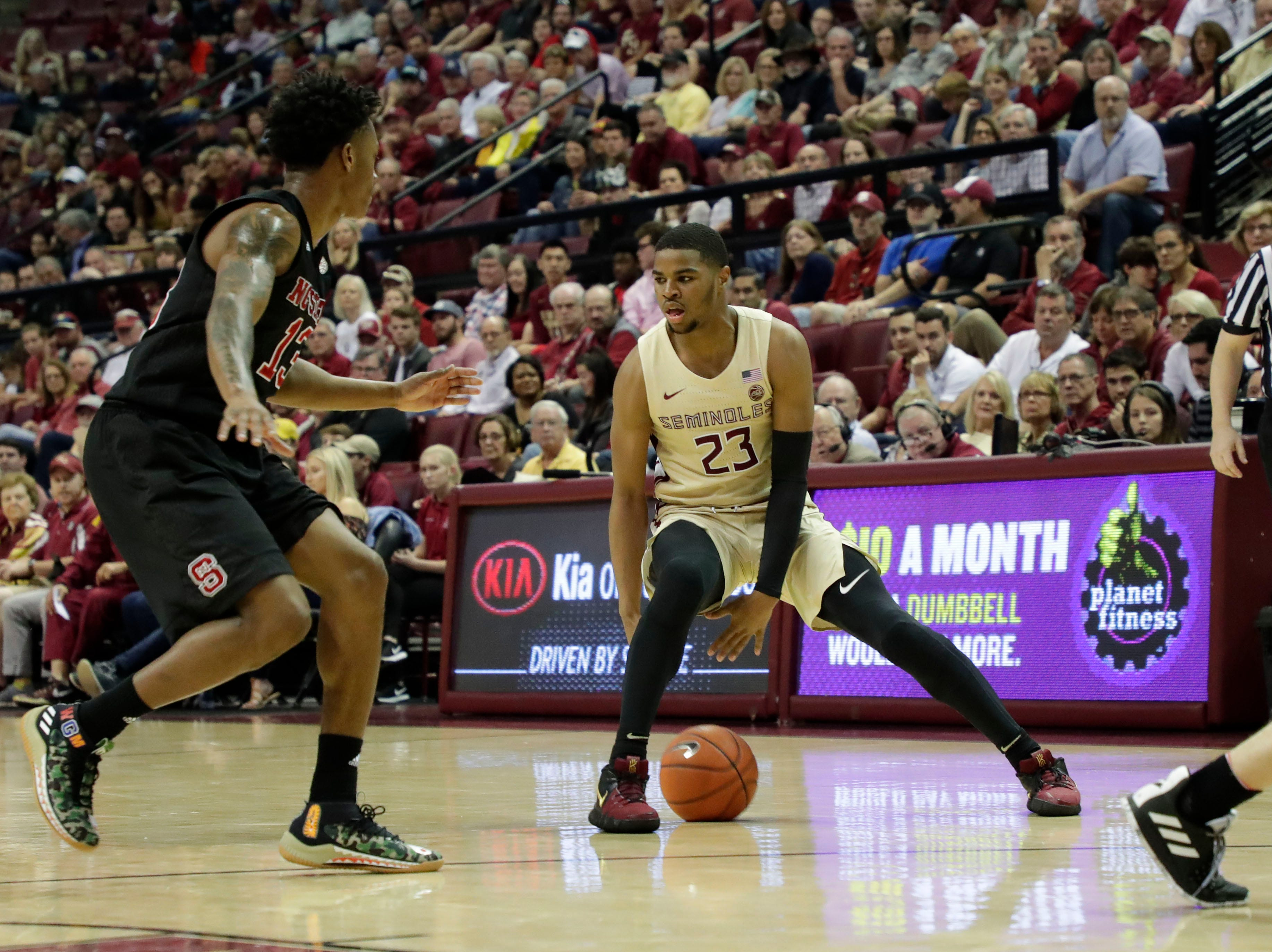 Florida State Seminoles guard M.J. Walker (23) dribbles as he looks for his next move. The Florida State Seminoles host the NC State Wolfpack at the Tucker Civic Center Saturday, March 2, 2019.
